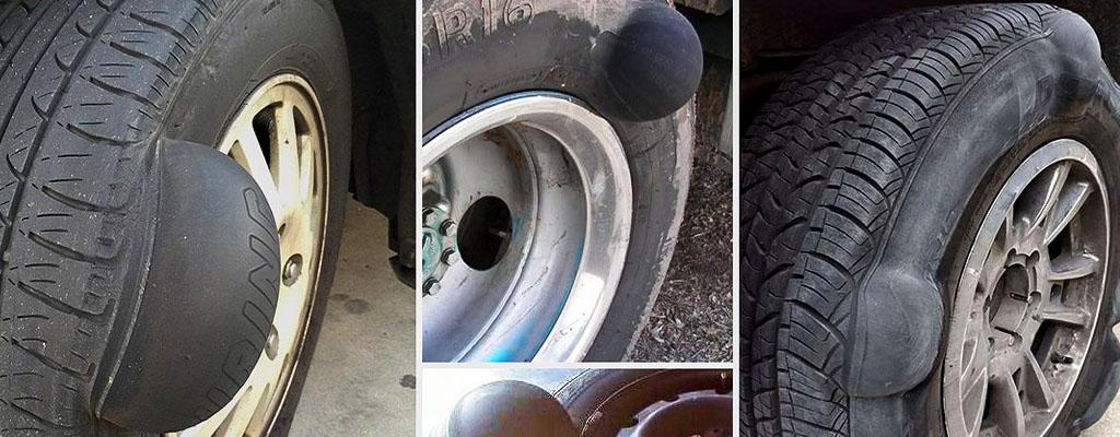 Na fotografiji so avto gume, na katerih so se pojavile izbokline.